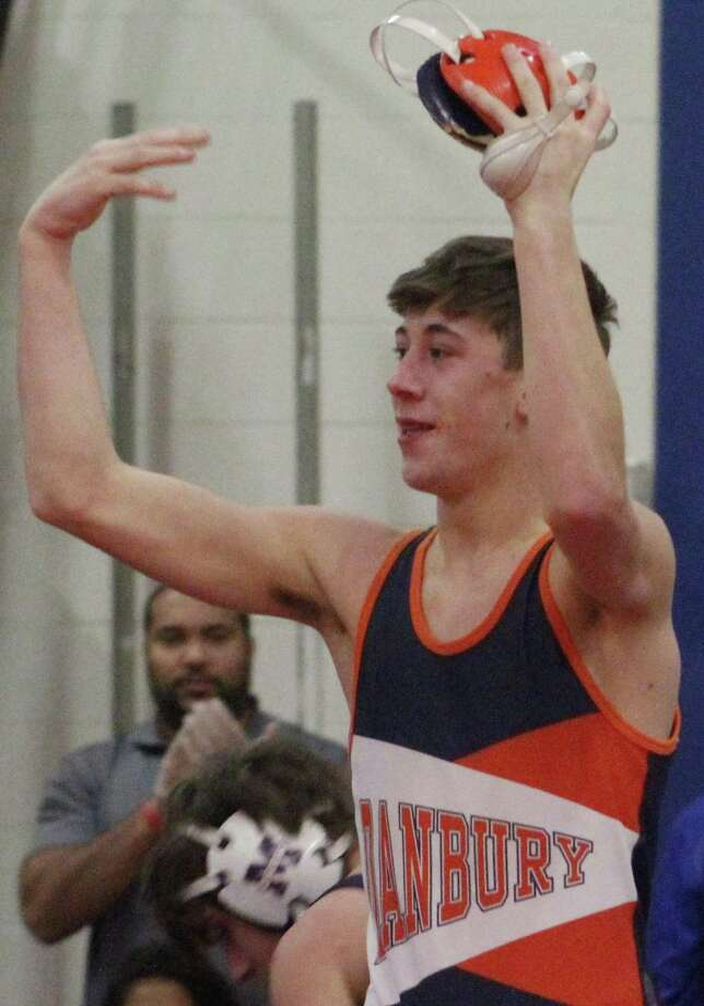 Danbury's Ben Leblanc celebrates his victory in the 113-pound match during the wrestling match against Mount Anthony at Danbury High School Jan. 15, 2018. Photo: Richard Gregory / Richard Gregory