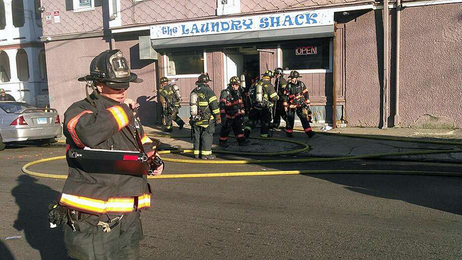 Around 2 p.m. on Dec. 10, 2018, Bridgeport, Conn., firefighters responded to The Laundry Shack at 672 Noble Ave. for a report of a fire. The laundromat is at the corner of Arctic and Hallett streets. Photo: Contributed Photo / Bridgeport Fire Department / Contributed Photo / Connecticut Post Contributed