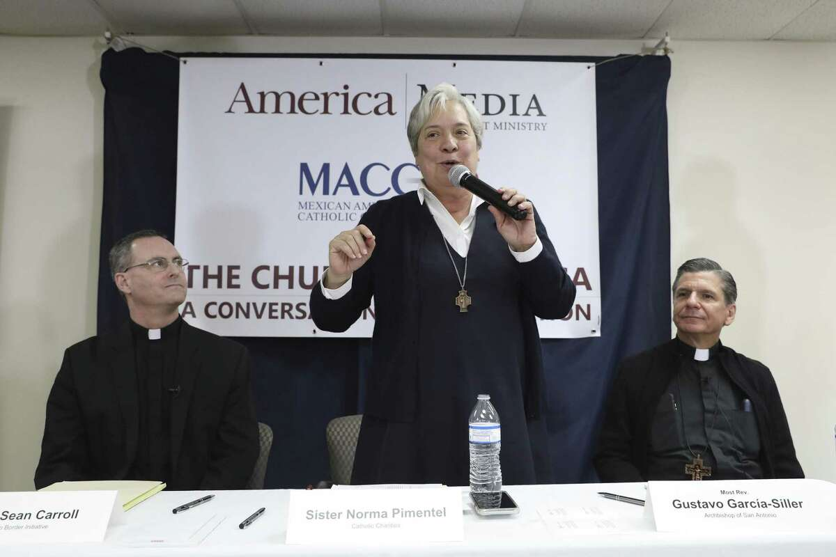 """Sister Norma Pimentel, Executive Director of Catholic Charities of the Rio Grande Valley, makes a remark during """"The Church in America, A Conversation on Immigration,"""" at the Mexican American Catholic College, Tuesday, Dec. 11, 2018. Also on the panel were Rev. Sean Carroll, Executive Director of The Kino Border Initiative, left, and San Antonio Archbishop Gustavo Garcia-Siller, right."""