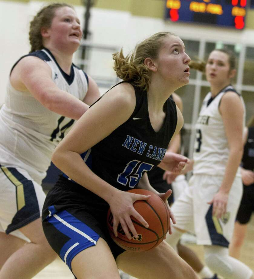 New Caney power forward Samantha Mathews (15) looks to shoot in the paint during the second quarter of a District 20-5A high school basketball game at Lake Creek High School, Tuesday, Dec. 11, 2018, in Montgomery. Photo: Jason Fochtman, Houston Chronicle / Staff Photographer / © 2018 Houston Chronicle