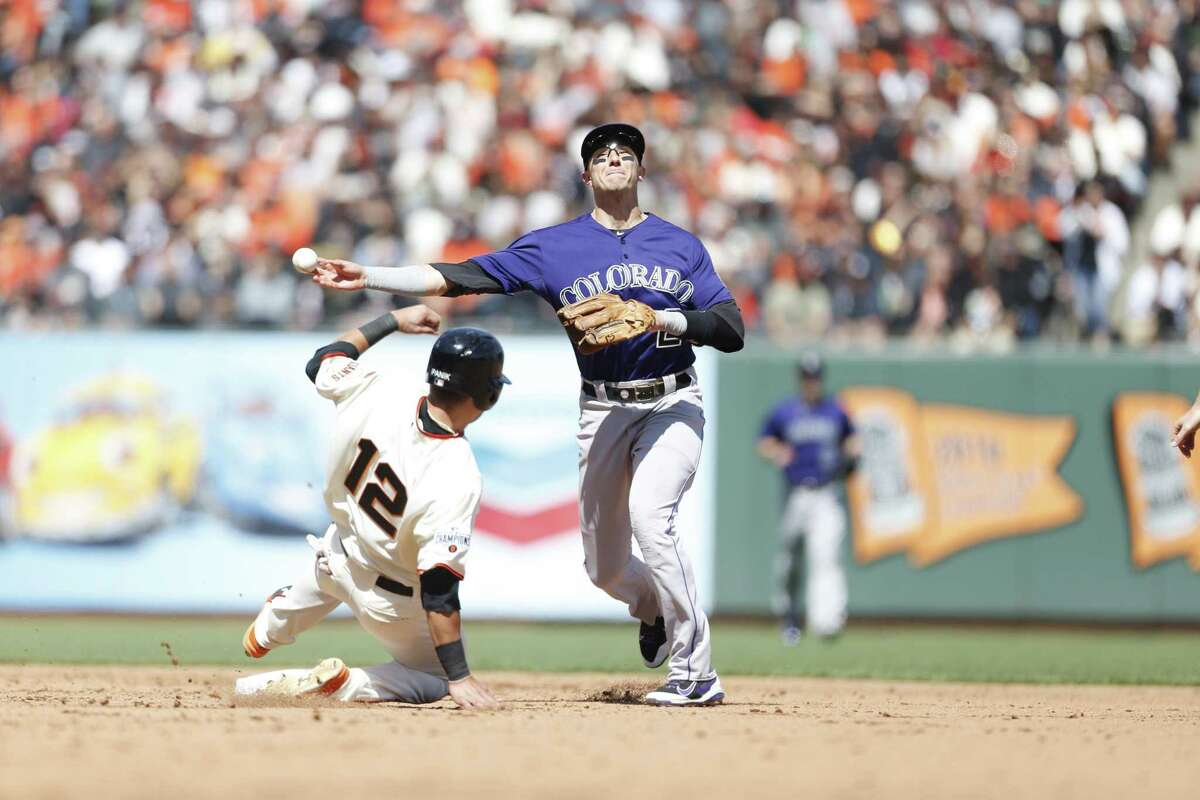 Troy Tulowitzki #2 of the Colorado Rockies gets the force out at second on Joe Panik #12 of the San Francisco Giants during the game at AT&T Park on April 13, 2015 in San Francisco, California. The Rockies defeated the Giants 2-0.