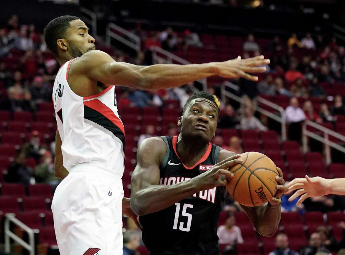 Houston Rockets' Clint Capela (15) looks to shoot as Portland Trail Blazers' Maurice Harkless defends during the first half of an NBA basketball game Tuesday, Dec. 11, 2018, in Houston. (AP Photo/David J. Phillip)