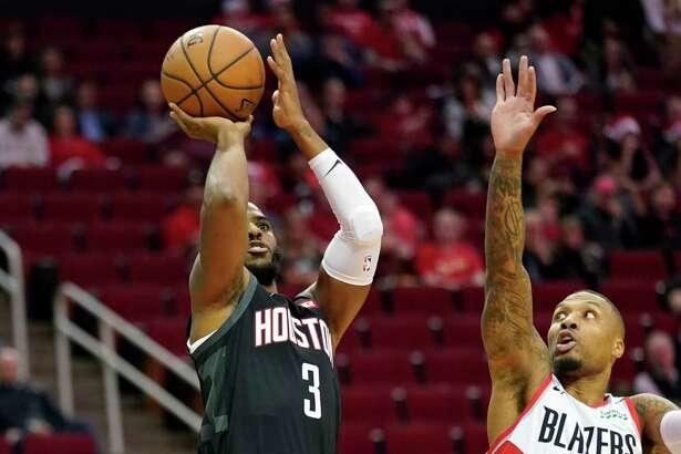 Houston Rockets' Chris Paul (3) shoots as Portland Trail Blazers' Damian Lillard (0) defends during the first half of an NBA basketball game Tuesday, Dec. 11, 2018, in Houston. (AP Photo/David J. Phillip)