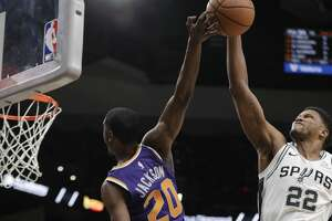 Phoenix Suns forward Josh Jackson (20) is blocked by San Antonio Spurs forward Rudy Gay (22) as he tries to score during the first half of an NBA basketball game, Tuesday, Dec. 11, 2018, in San Antonio. (AP Photo/Eric Gay)