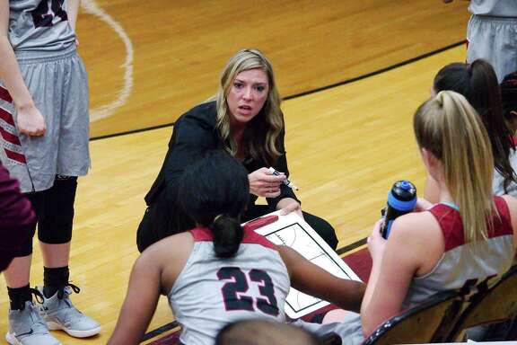 Pearland basketball coach Lauren Martens speaks to her team during a break against Brazoswood Tuesday at Pearland High School.