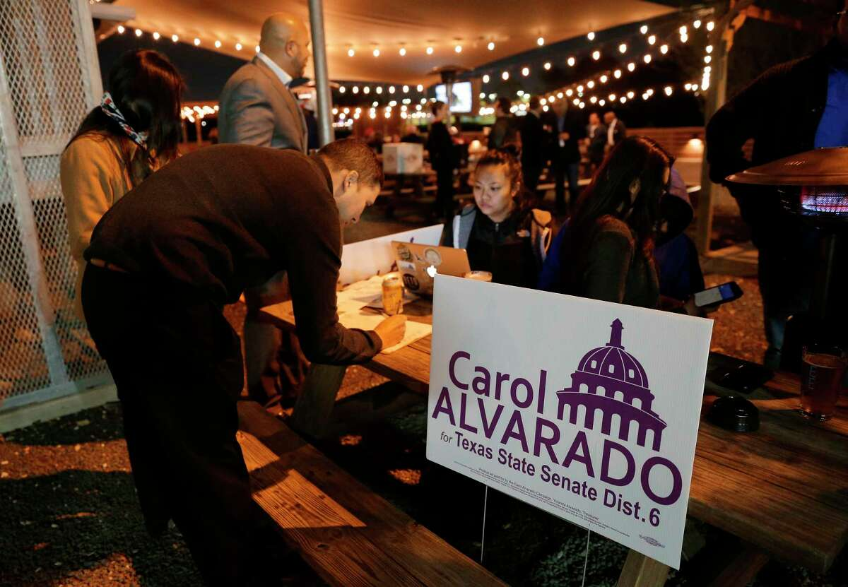 Supporters of Carol Alvarado wait outside for her to arrive at her watch party held at Raven Tower Tuesday, Dec. 11, 2018 in Houston, TX.