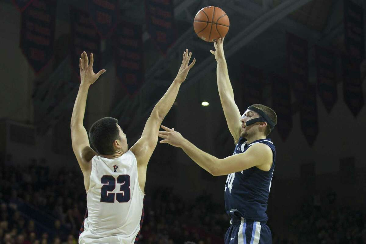 PHILADELPHIA, PA - DECEMBER 11: Joe Cremo #24 of the Villanova Wildcats shoots the ball against Michael Wang #23 of the Pennsylvania Quakers in the first half at The Palestra on December 11, 2018 in Philadelphia, Pennsylvania. (Photo by Mitchell Leff/Getty Images)