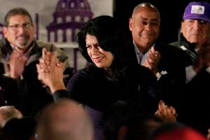 Carol Alvarado high fives attendants from the stage as she gives remarks at her watch party held at Raven Tower Tuesday, Dec. 11, 2018 in Houston, TX.