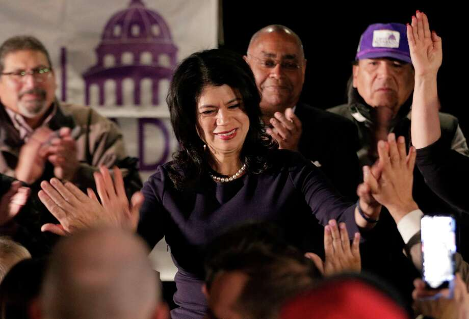 Carol Alvarado high fives attendants from the stage as she gives remarks at her watch party held at Raven Tower Tuesday, Dec. 11, 2018 in Houston, TX. Photo: Michael Wyke, Contributor / © 2018 Houston Chronicle