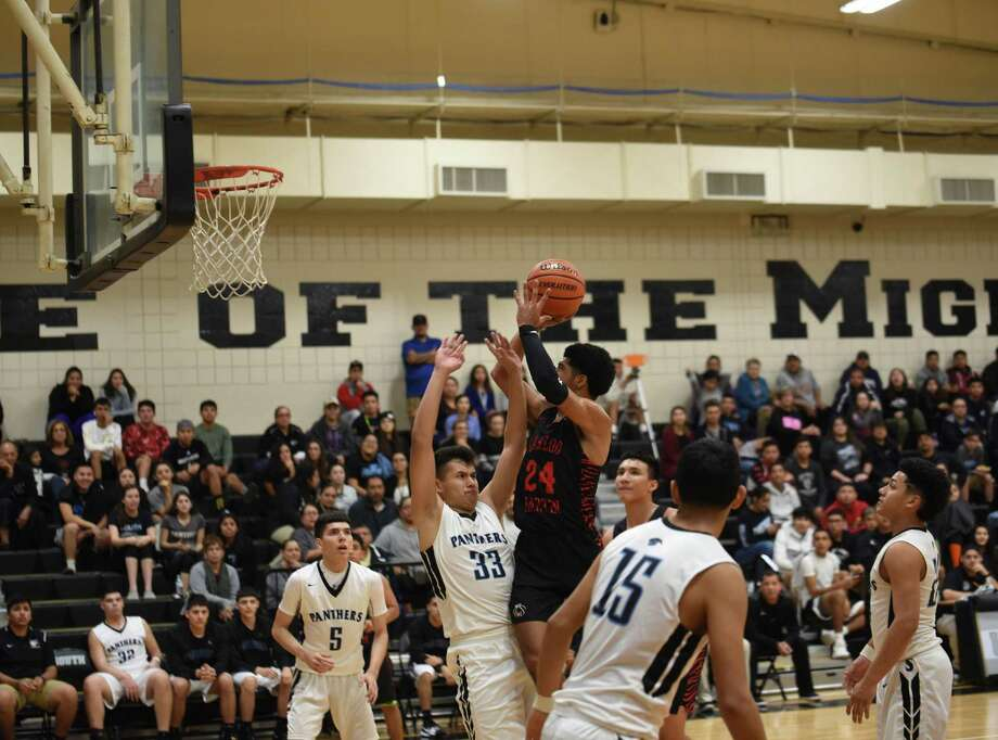 Mathew Duron was an assist shy of a triple-double Tuesday as he scored 16 points and grabbed 11 rebounds in Martin's 84-78 double-overtime victory at United South. Photo: Christian Alejandro Ocampo /Laredo Morning Times / Laredo Morning Times