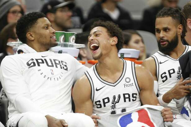 Bryn Forbes #11 of the San Antonio Spurs laughs with teammates Rudy Gay,L, and Patty Mills in closing minutes of game against the Phoenix Suns. Phoenix Suns v San Antonio Spurs at AT&T Center on Tuesday, December 11, 2018.