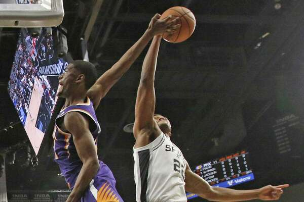 Rudy Gay #22 of the San Antonio Spurs blocks shot of Deandre Ayton #22 of the Phoenix Suns. Phoenix Suns v San Antonio Spurs at AT&T Center on Tuesday, December 11, 2018.