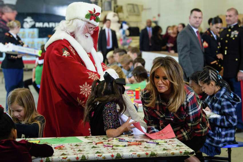 US First Lady Melania Trump attends with Father Christmas personificator a Toys for Tots event at Joint Base Anacostia-Bolling in Washington, DC, on December 11, 2018. - Toys for Tots is a program run by the United States Marine Corps Reserve which distributes toys to children whose parents cannot afford to buy them gifts for Christmas. (Photo by NICHOLAS KAMM / AFP)NICHOLAS KAMM/AFP/Getty Images