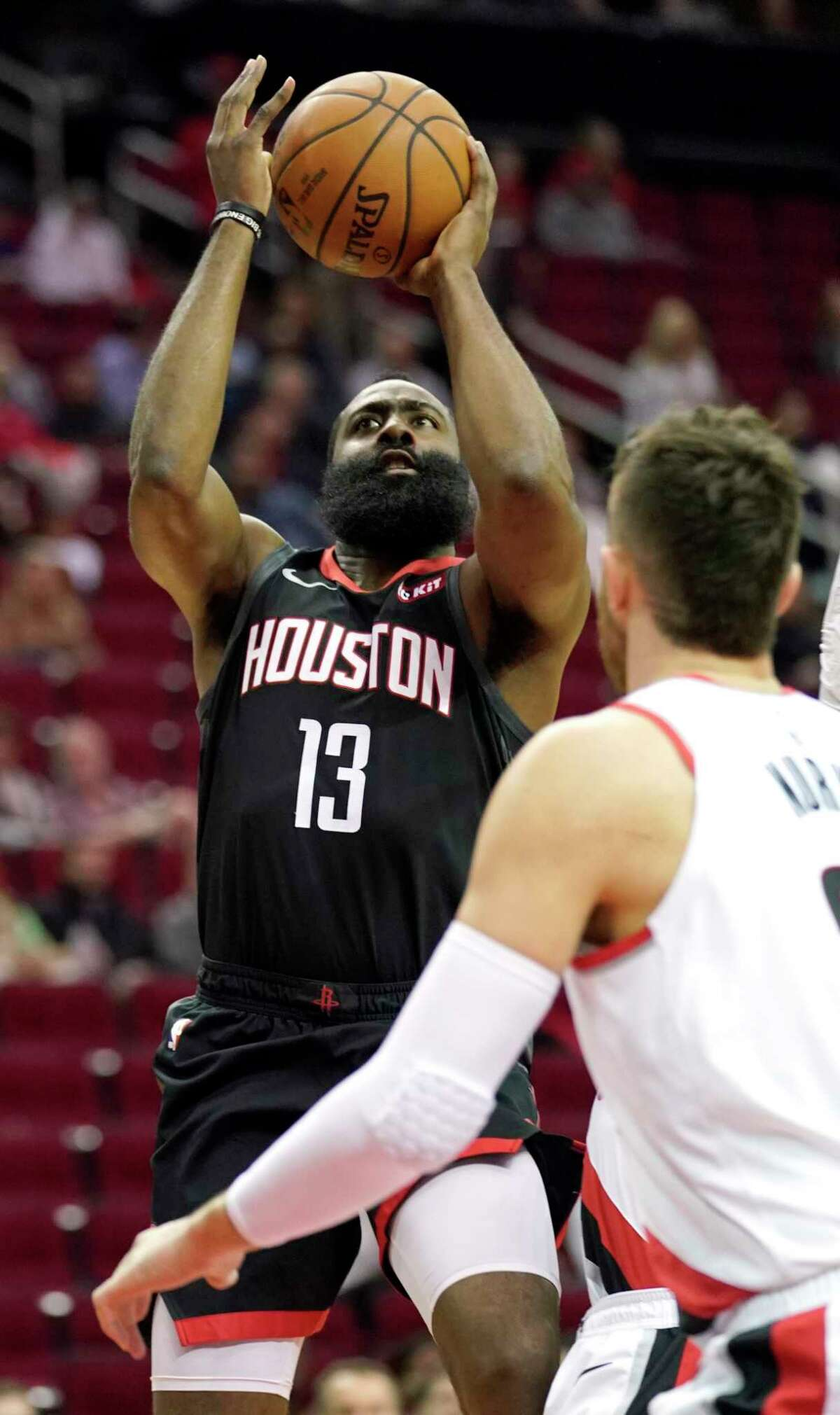 Houston Rockets' James Harden (13) shoots against the Portland Trail Blazers during the first half of an NBA basketball game Tuesday, Dec. 11, 2018, in Houston. (AP Photo/David J. Phillip)