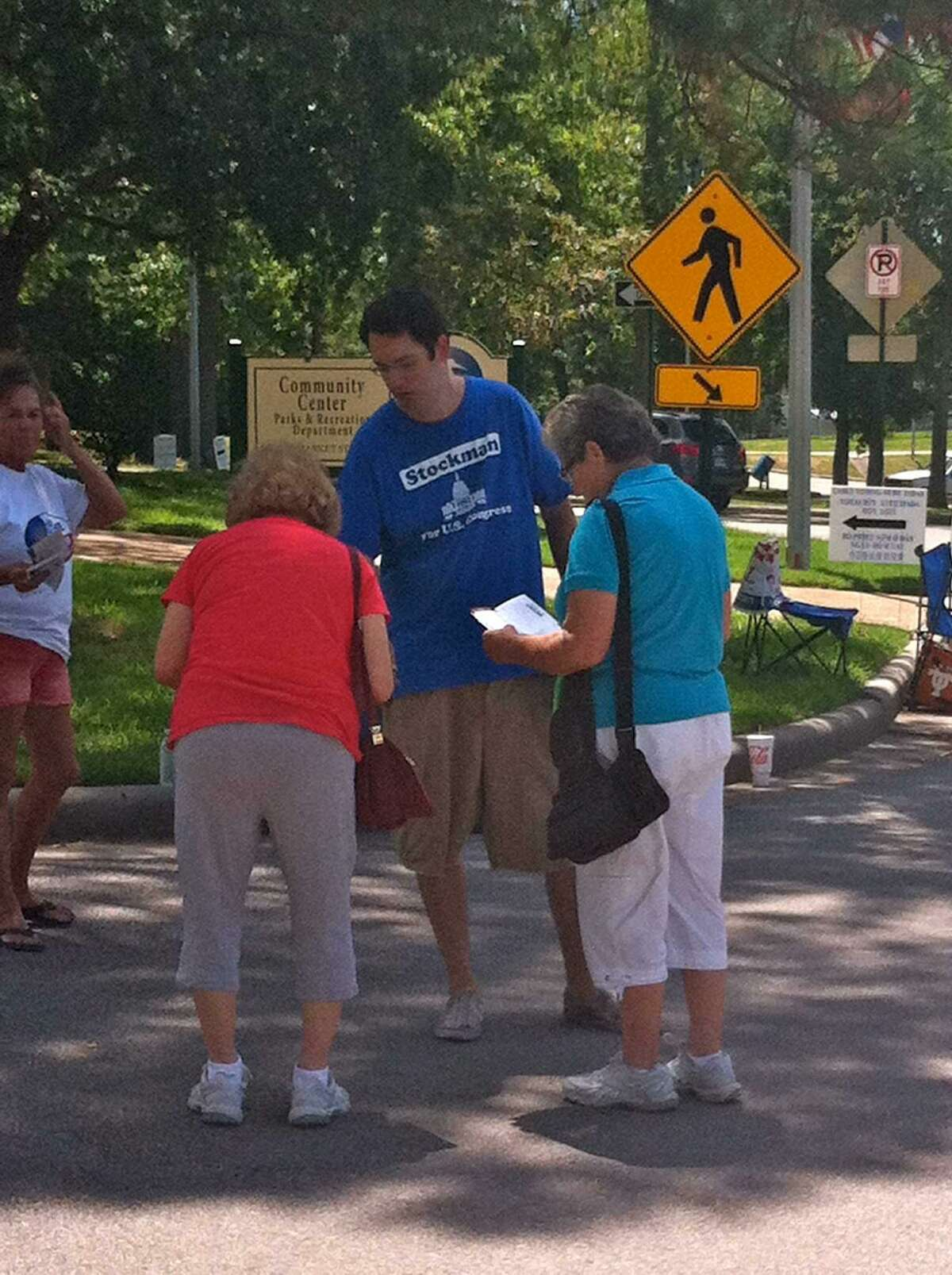 Stockman's campaign employee, Thomas Dodd, and other poll workers on election day in 2012 in Baytown. (Dodd in the center in the blue shirt). Dodd and another Stockman congressional staffer, Jason Posey, were fired in mid October. hand-in photo