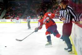 Capitals left wing Alex Ovechkin (8) fires a shot during the third period of Washington's win Tuesday night against Detroit. Ovechkin's shot would find the net to give him the 21st hat trick of his career.