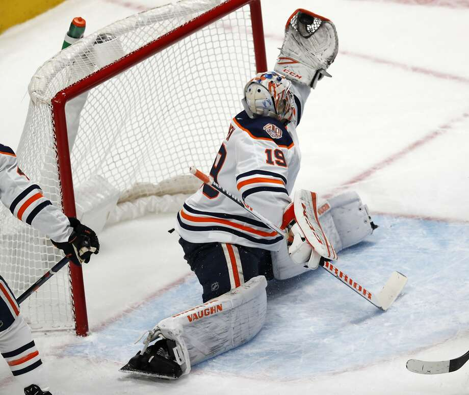 Oilers goaltender Mikko Koskinen makes a glove save of a shot against the Avalanche in the third period, one of his 39 stops. Photo: David Zalubowski / Associated Press