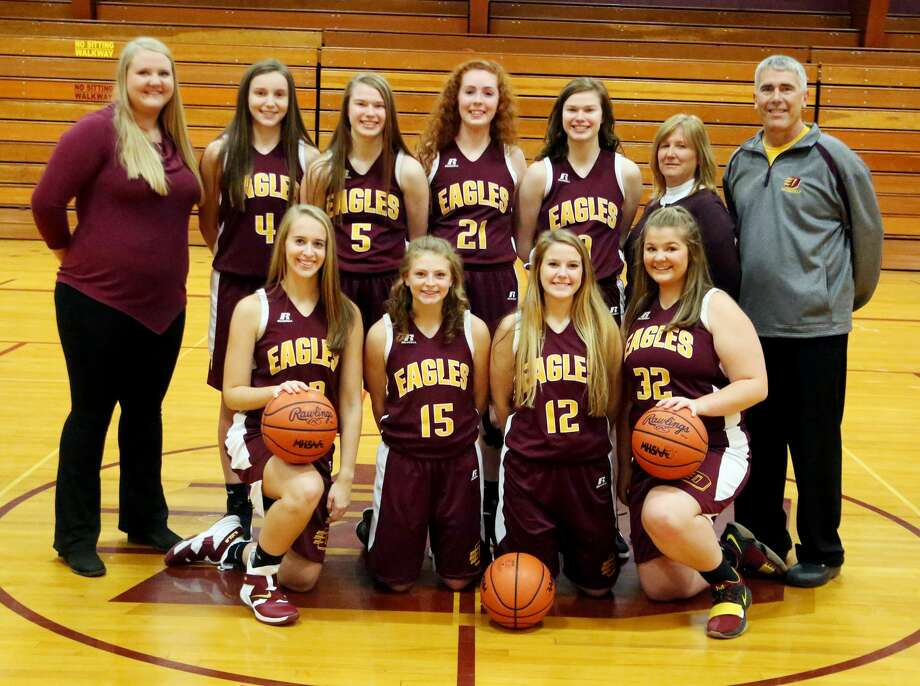 Members of the Deckerville varsity girls basketball Morgan Armstead, Kaylee Wagester, Lauren Flanagan and Haileigh Foote (back row) assistant coach Tiffany Mason, Addison Williams, Ella Watson, Emma Beaver, Claire Watson, assistant coach Maureen Kirkpatrick and head coach Doug Kirkpatrick. Photo: Paul P. Adams/Huron Daily Tribune