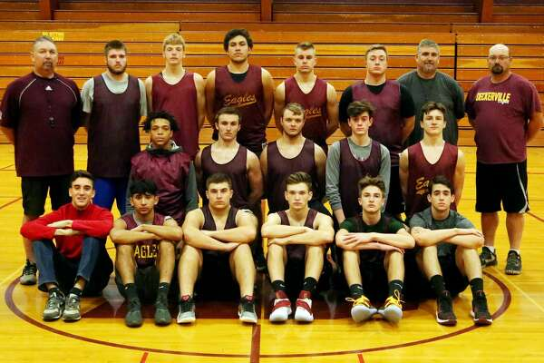 Members of the Deckerville varsity boys basketball team are (front row from left) Luis Cambronero, Juan Carlos Ibarra, Conner Lamont, Isaac Keinath, Traiten Colesa and Maurilo Arantes (middle row) Derek Snyder, Travis Trigger, Justin Trigger, Trevor Barker and Joseph Devault (back row) assistant coach Lou Garza, Richie Barker, Lucas Asher, Josemaria Abreu, Jeffrey Frost, Curtis Vogel, head coach Dale Stolicker and assistant coach Michael Benjey.