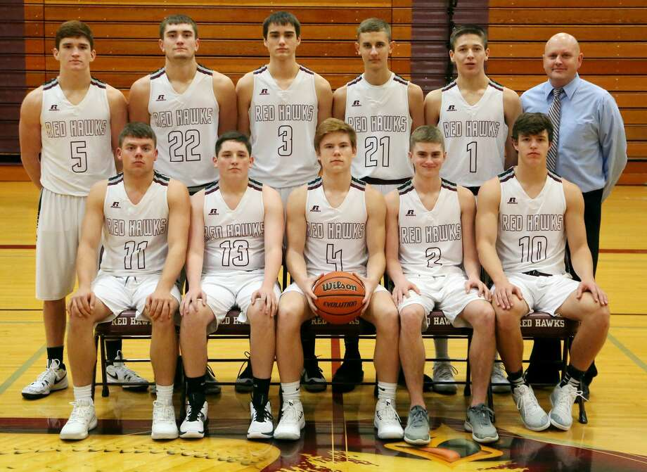 Members of the Cass City boys varsity basketball team are (front row from left) Collen Wrubel, Tyler Czekai, Hadyn Horne, Bryce Fernald and Sandyn Cuthrell (back row) Luke Stern, Zack Beecher, Landon Schenk, Dale Kaake and Kendall Anthes. Photo: Paul P. Adams/Huron Daily Tribune