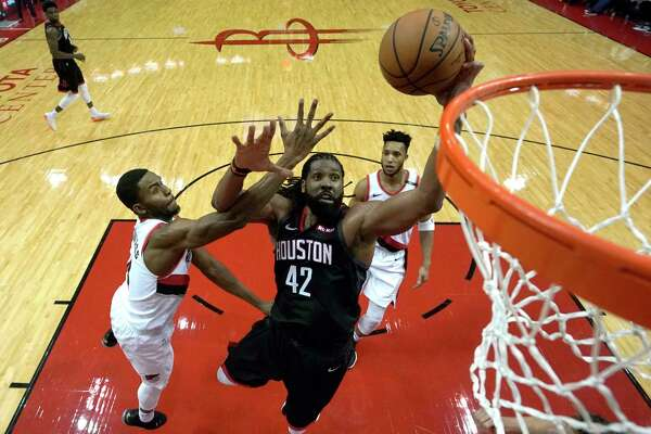 Houston Rockets' Nene Hilario (42) goes up for a shot as Portland Trail Blazers' Maurice Harkless, left, defends during the second half of an NBA basketball game Tuesday, Dec. 11, 2018, in Houston. The Rockets won 111-103. (AP Photo/David J. Phillip)