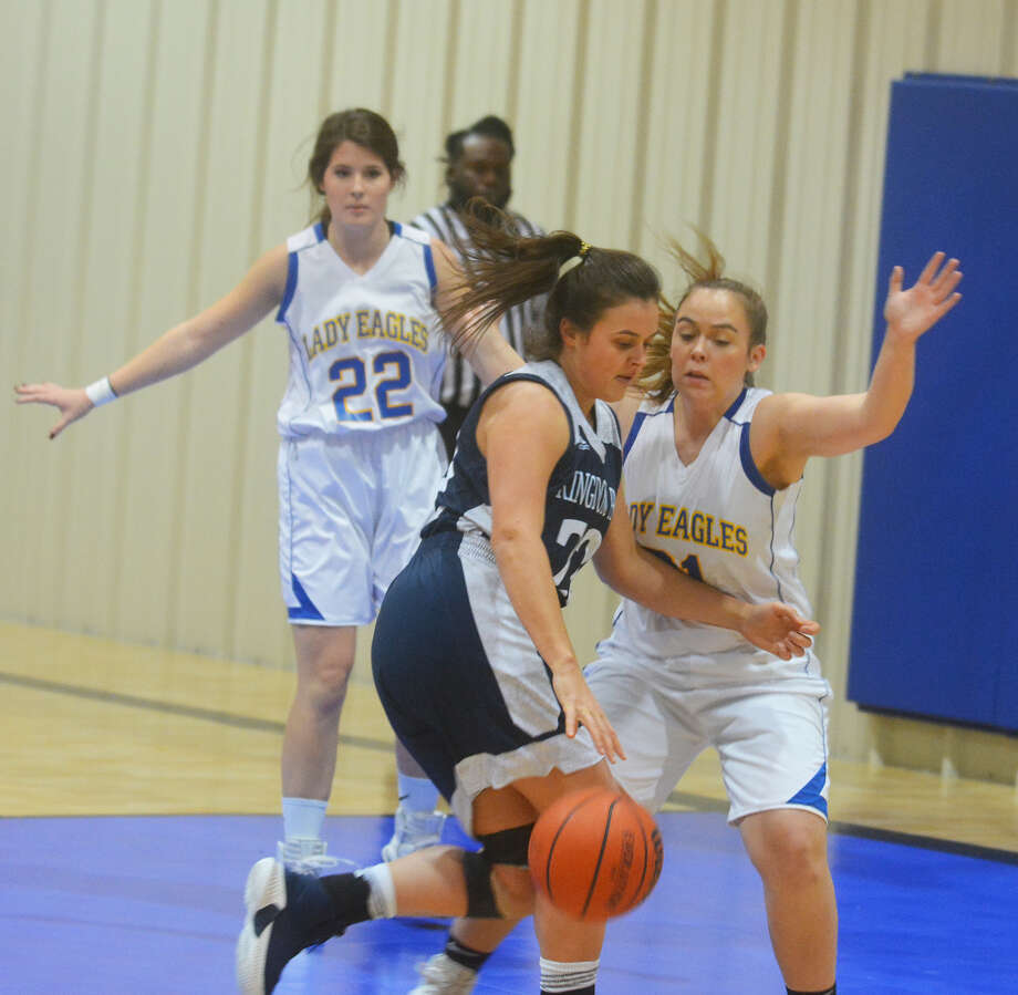 Plainview Christian Academy Lady Eagle Ashlynn Morton tries keep Kingdom Prep Academy's Maggie Nicholson from scoring a layup during the TAPPS District 1-1A girls basketball game on Tuesday in Plainview. Photo: Alexis Cubit/Plainview Herald
