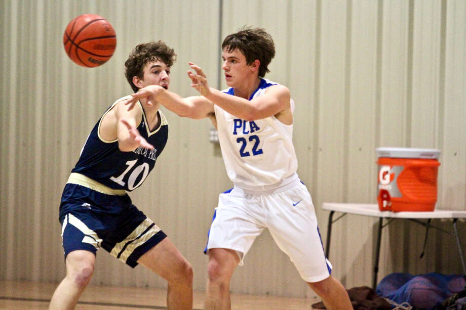 Plainview Christian Academy senior Jonathan Sammann passes the ball back to the top of the key during the Eagles TAPPS District 1-1A opener against Kingdom Prep on Tuesday night in Plainview. Photo: Courtesy Of Don Brown