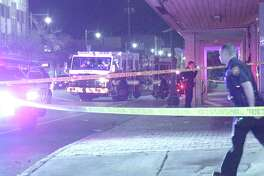 The victim was lying on the sidewalk with another man in the 1300 block of East Commerce. The suspect walked past him at about 10:45 p.m., then came back and started shooting the man, police said.