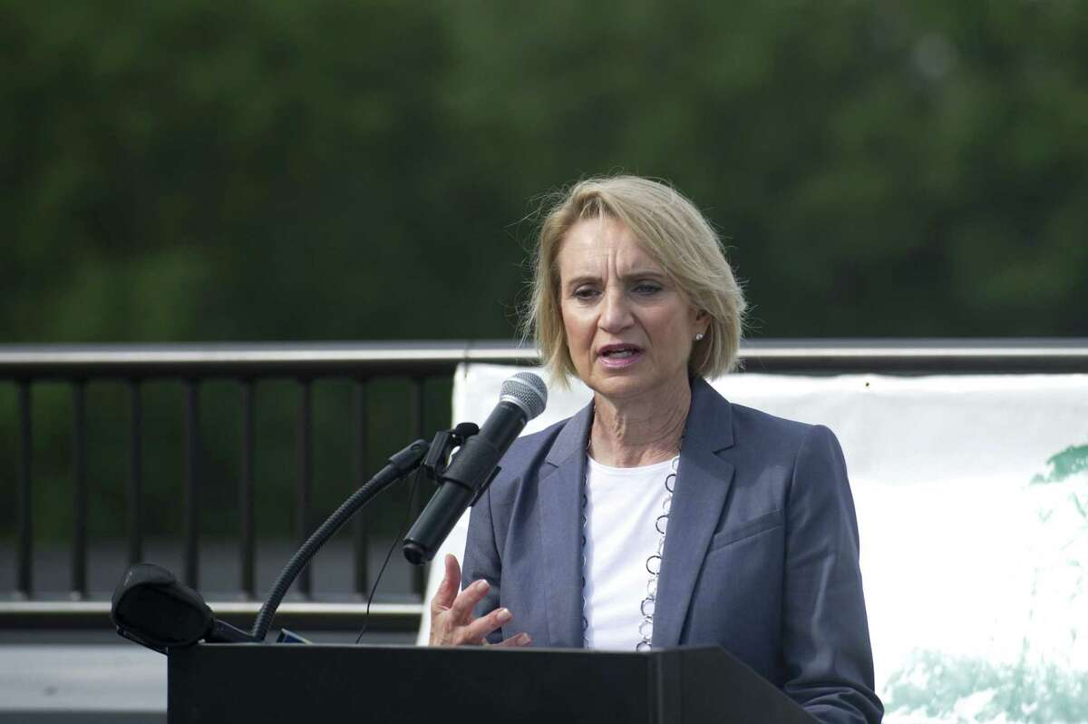 Connecticut Department of Housing commissioner Evonne Klein speaks during a formal dedication ceremony for Park 215, a mixed-use development adjacent to Leone Park, in west Stamford, Conn. on Wednesday, Oct. 10, 2018. The five-story building contains 78 one and two bedroom mixed income units and is Charter Oak Communities latest effort to revitalize the former Vidal Court housing complex.