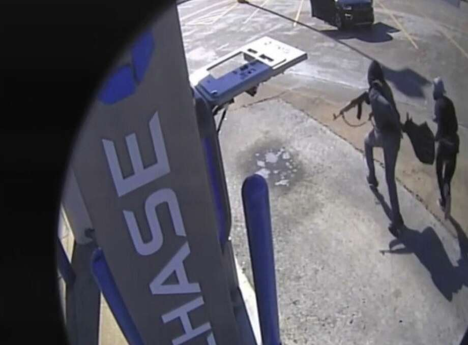 Authorities are searching for a pair of armed robbers who opened fire with an AK-47 during an armored truck robbery in broad daylight Monday.Anyone with information about their whereabouts is urged to call Houston Crime Stoppers at 713-222-TIPS (8477). Photo: FBI Houston