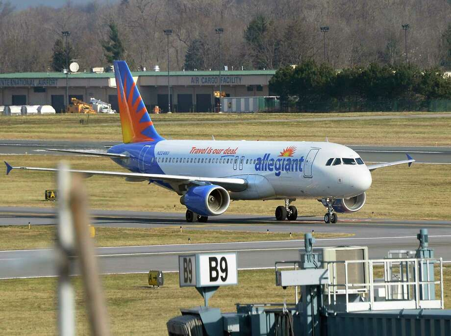 An Allegiant Air jetliner taxis to its gate as they begin serving Albany International Airport Wednesday Dec. 12, 2018 in Colonie, NY.  (John Carl D'Annibale/Times Union) Photo: John Carl D'Annibale, Albany Times Union / 20045684A