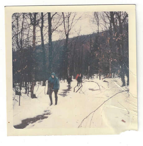 "In a never-before-published photo by hiker Keith Dayer, students from the Shenendehowa Hiking Club trudge along part of the Long Trail in the Green Mountains on Dec. 14, 1968.  Photo: Eric ""Rick"" Mogren, Provided"