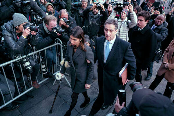 Michael Cohen, center, President Donald Trump's former lawyer, accompanied by his children Samantha, left, and Jake, right, arrives at federal court for his sentencing, Wednesday, Dec. 12, 2018, in New York, for dodging taxes, lying to Congress and violating campaign finance laws.