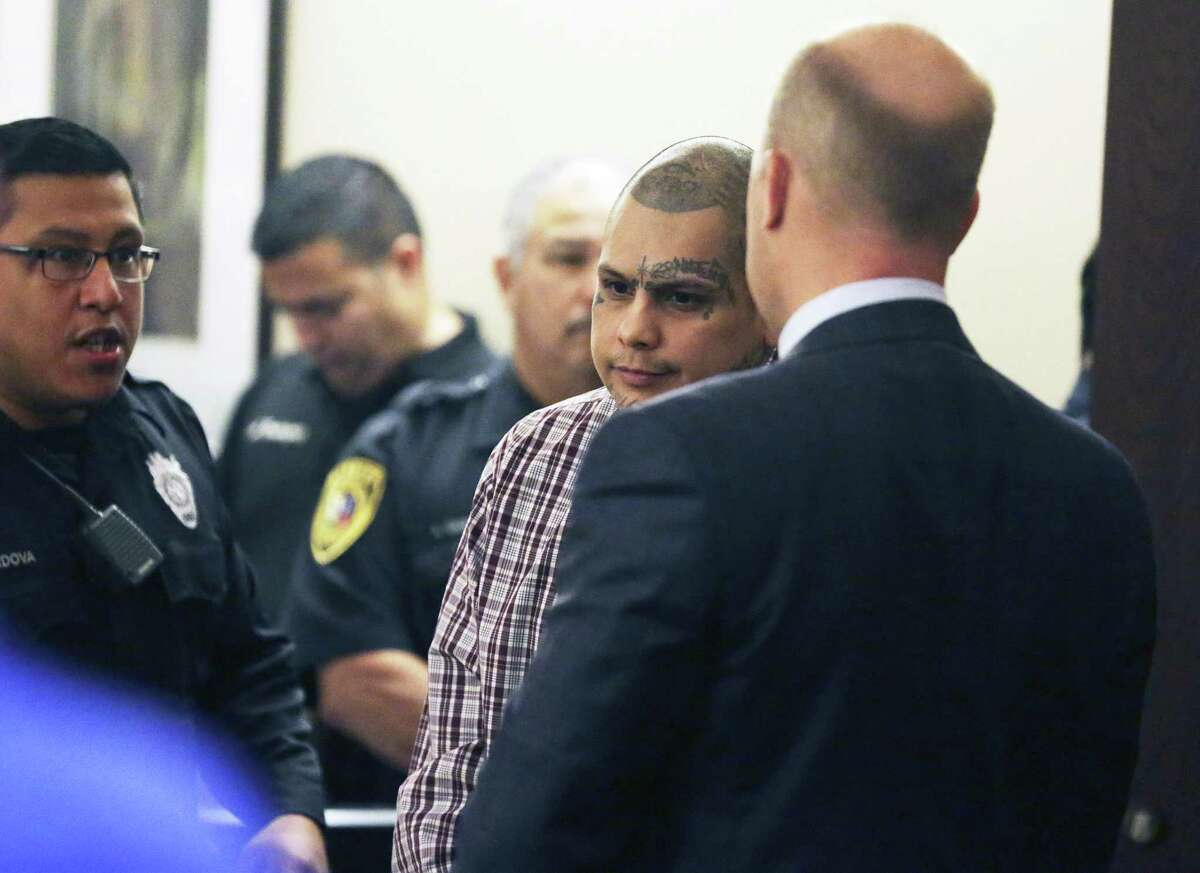 The defendant stands and exits the courtroom Wednesday.
