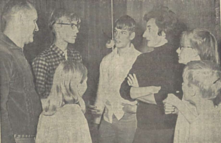 Eric Mogren and his family were interviewed by the media when they returned home the night after being rescued. Pictured here, from left, are Eric's dad, Tom, Eric, his brother Ron, his mom Loraine, his sister Leslie and brother Tom.  Eric's sister Rosemary, with her back to the camera, was 8 at the time and remembers her parents waking her up to pose for the photo. She recalled her mother's face being ashen when she told her that Eric didn't make it home the previous night. The photograph was published in the Knickerbocker News on Dec. 17, 1968. Photo: Knickerbocker News