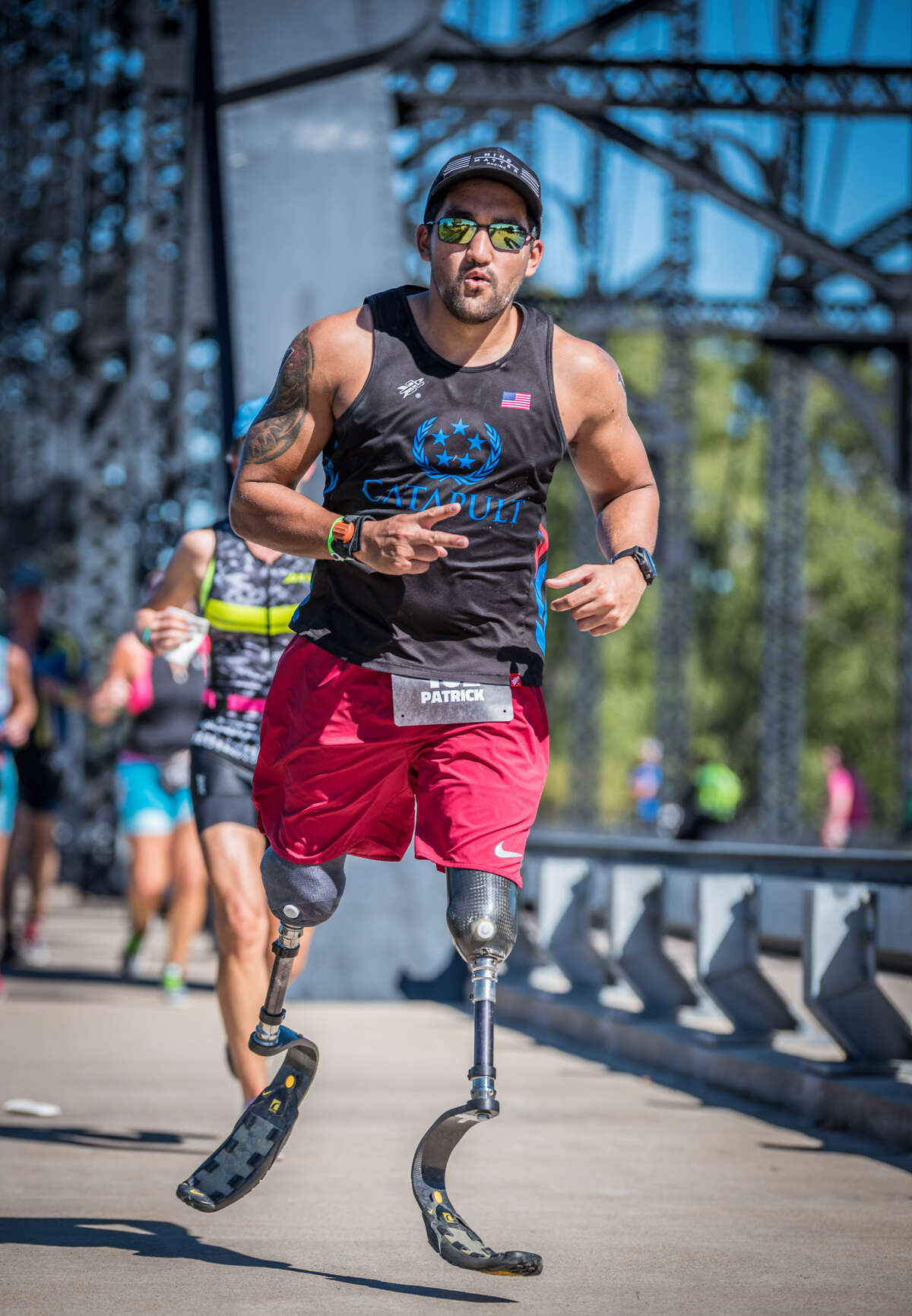 Patrick Pressgrove Patrick Pressgrove endured an emotional year. Not only did the double-amputee reunite with his birth mother, Pressgrove also participated in Chevron's Houston Marathon. In October, he competed in his inaugural Ironman race.