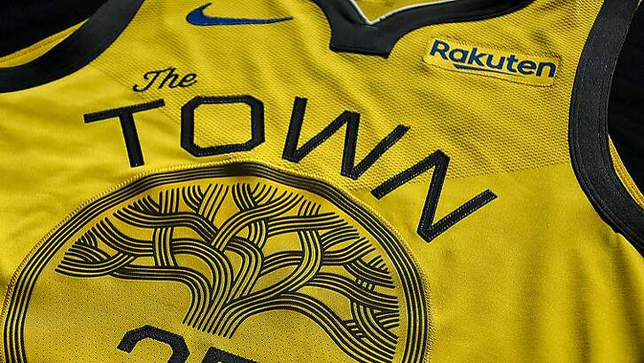 """The Warriors unveiled their new gold """"Town"""" jerseys Wednesday."""