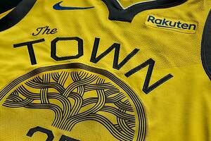 "The Warriors unveiled their new gold ""Town"" jerseys Wednesday."