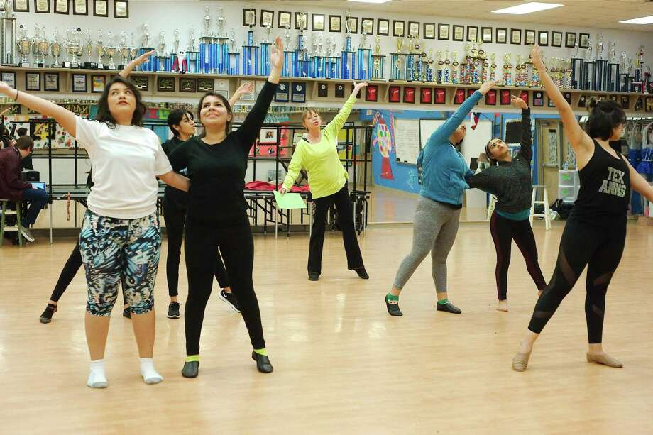 "Dancers Kassandra Hernandez, Aracely Garza, Adriana Hernandez, Stephanie Arrendondo, Melissa Ramirez, and Xiomara Orellana learn a new dance move from choreographer Peggy Hinojosa, center, during rehearsal for ""The Wizard of Oz"" at at Sam Rayburn High School. The musical Photo: Kirk Sides / Staff Photographer / © 2018 Kirk Sides / Houston Chronicle"