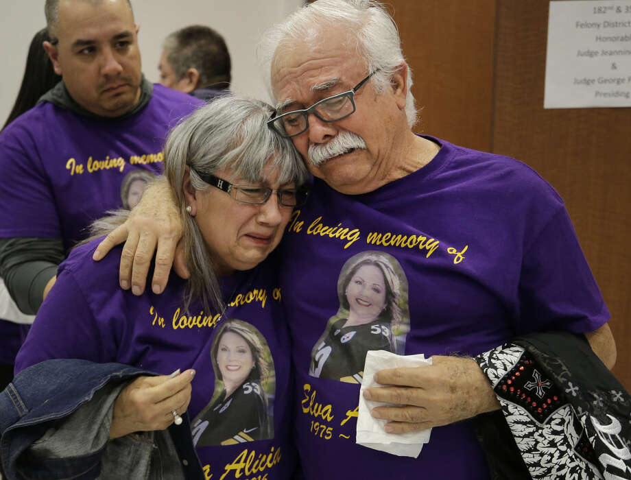 Norma Flores and her husband, Jose Flores, comfort each other as they leave from the 351st District Criminal Court Friday, Jan. 26, 2018, in Houston after the sentencing of Elrey Gonzalez, who murdered their daughter Elva Gonzalez.  Elrey Gonzalez, a registered sex offender, was charged with capital murder for attempting to kidnap, then killing his estranged 41-year-old Elva Gonzalez in Baytown on October 30, 2016. Gonzalez pleaded guilty to capital murder in exchange for the state promising not to seek the death penalty. Photo: Melissa Phillip/Staff Photographer
