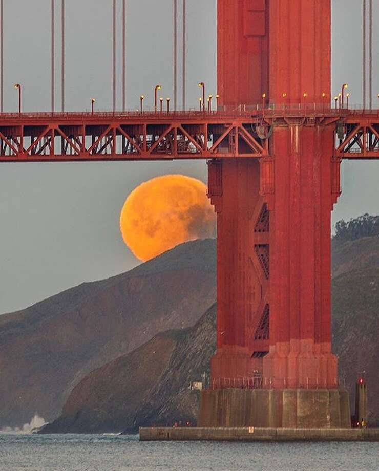 @the415guy 's photo of January's lunar eclipse setting behind the Golden Gate Bridge was the most popular image that was regrammed on SFGate's Instagram.  It was liked 7,800 times. Photo: Instagram / The415guy