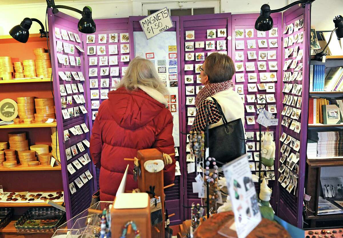 Bernie Walman of Schodack, left, and her friend Beth Secor of Schodack shop at the Christmas craft fair at the Shaker Heritage Society on Monday, Nov. 30, 2015 in Albany, N.Y. (Lori Van Buren / Times Union)