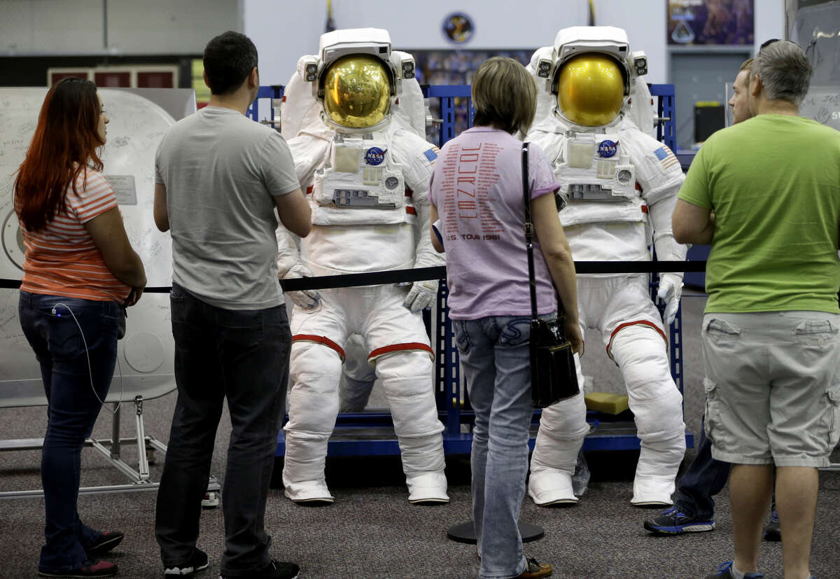 People tour the Space Vehicle Mockup Facility in Building 9NW during the open house at NASA Johnson Space Center Saturday, Oct. 27, 2018, in Houston.