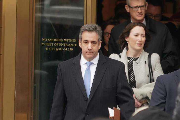Michael Cohen, center, the former lawyer for President Donald Trump, exits federal court after his sentencing in Manhattan, Dec. 12, 2018. Cohen was sentenced to three years in prison on Wednesday morning for his role in a hush-money scandal that could threaten Trump's presidency by implicating him in a scheme to buy the silence of two women who said they had affairs with him.
