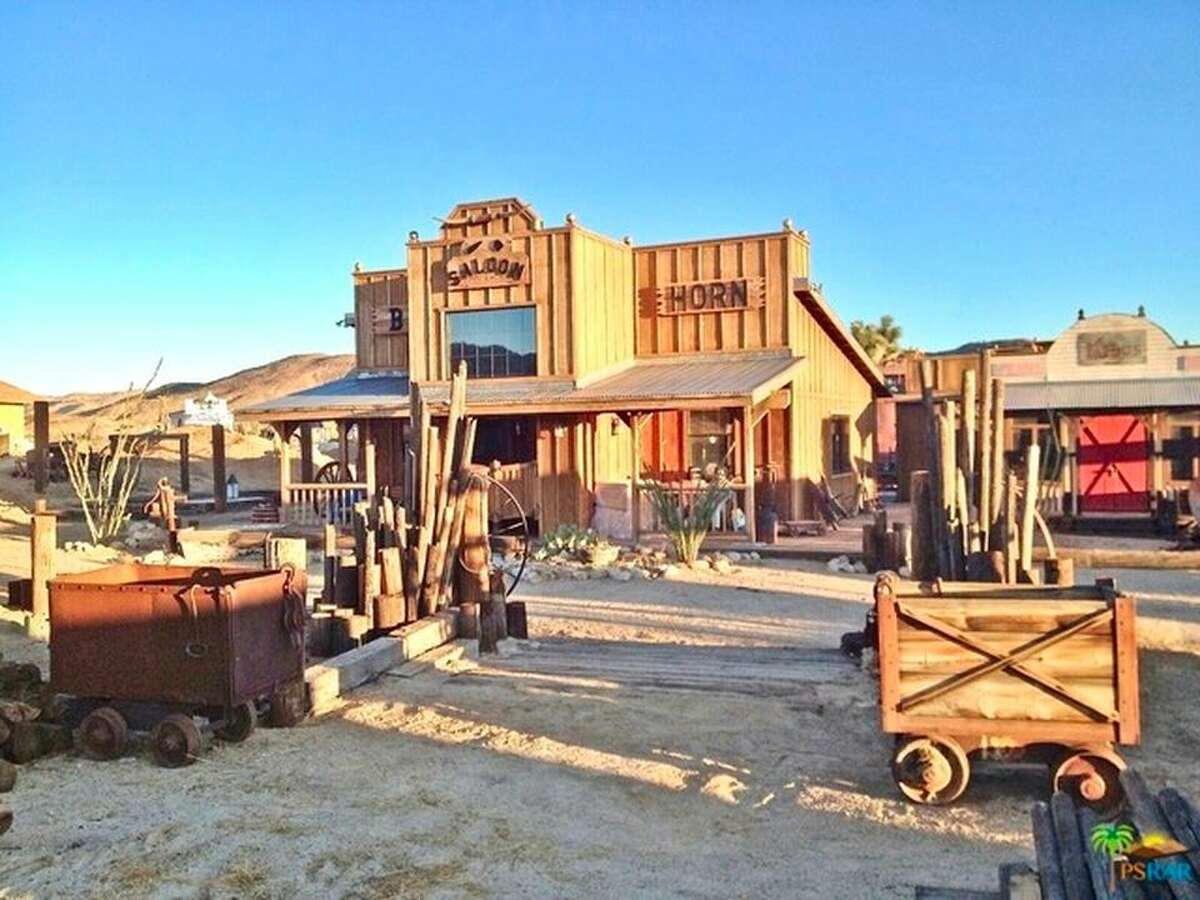 Fifteen miles from Joshua Tree National Park, a renovated ranch house in the middle of what looks like a Western movie set is listed for $1.495 million.