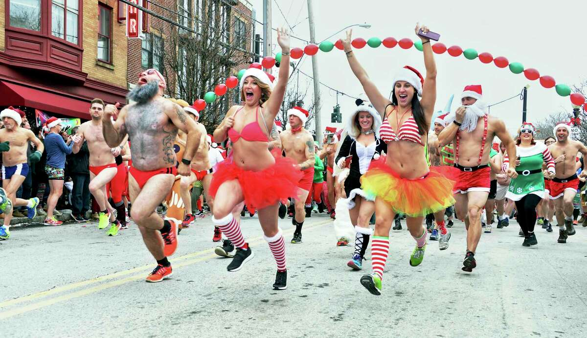 Participants brave the cold at the start of the 12th Annual Santa Speedo Sprint down Lark Street Saturday Dec. 16, 2017 in Albany, NY. (John Carl D'Annibale / Times Union)