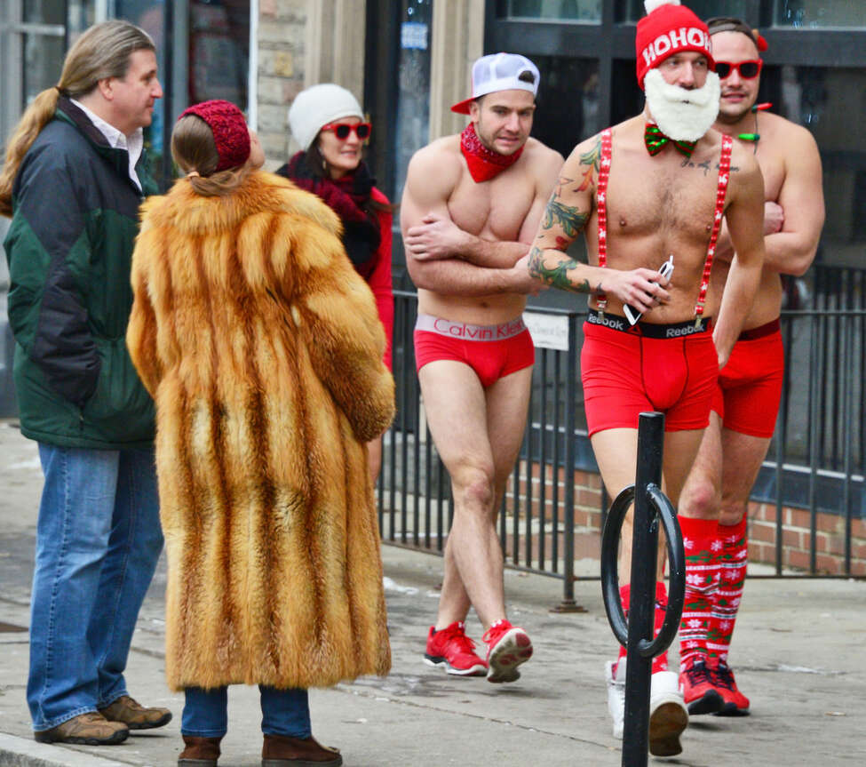Participants brave the cold on their way to the 12th Annual Santa Speedo Sprint down Lark Street Saturday Dec. 16, 2017 in Albany, NY. The 800 meter run raises money for the Albany Damien Center and the HIV/AIDS program at Albany Medical Center. (John Carl D'Annibale / Times Union)
