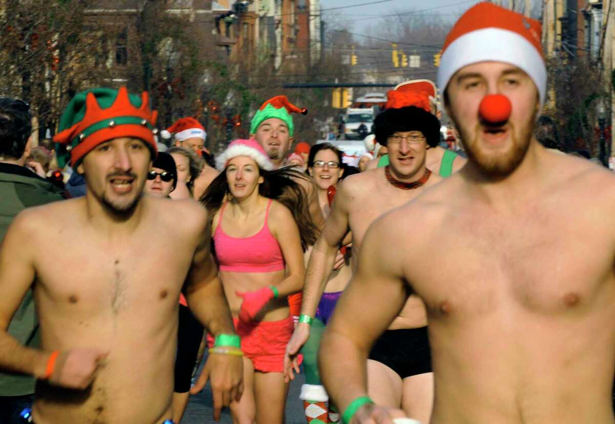 runners head to the finish during the 5th Annual Santa Speedo Sprint in Conjunction with the 4th Annual Winter WonderLark in Albany 12/11/2010. ( Michael P. Farrell/Times Union )