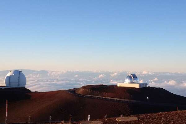 Several of Mauna Kea's telescopes are seen atop the 13,796-foot peak, the highest island mountain (not counting New Guinea's spines) and a place free of light pollution and with many clear days, perfect for observing the stars above.