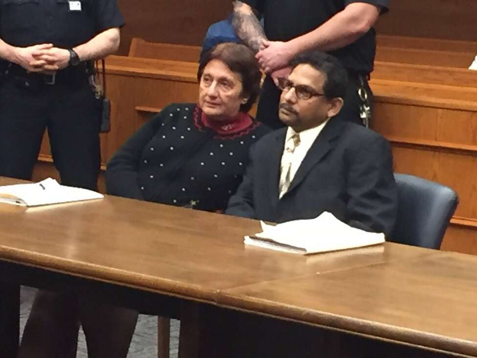 Tarchand Lall, right, and his attorney, Cheryl Coleman, await the jury's verdict in Schenectady where he was tried on allegations he arraigned the murder for hire of another man to collection insurance.